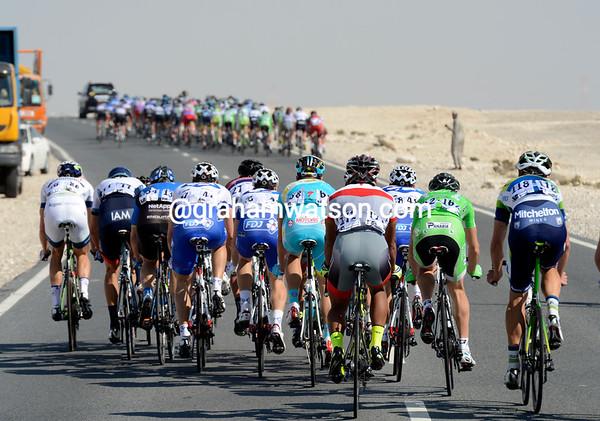 Wind has split the peloton as it turns back towards Al Wakra...