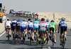 Wind has split the peloton as it turns back towards Al Wakra...