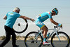 Poetry in motion - Evan Huffan gets a perfect wheel change from his Astana mechanic...