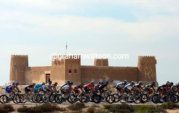 The peloton passes the fort of Al Zubarah near the northern coast of Qatar...