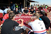 Servais Knaven conducts a team talk with his Sky riders before the stage-start...