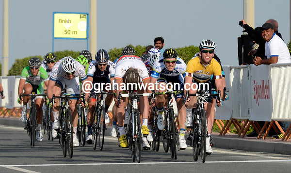 Mark Cavendish wins stage five from Yauheni Hutarovich and Aidis Kruopis...