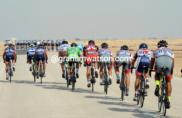 The wind has split the peloton now, ejecting the weaker riders out the back...