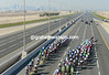 Omega paces 1/3rd of the peloton, Radio Shack paces the other 2/3rds as the skyline of Doha looms on the horizon...
