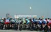The peloton starts the last stage near Qatar's gas refineries at Sealine Beach Resort...