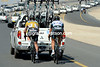 Cavendish and Matteo Trentin shelter behind a team car, but the peloton has sat up and is waiting for the race-leader...