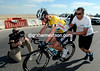 Cavendish recovers from the fall and gets pushed along by Wilfried Peeters...