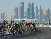 Cavendish is near the head of the peloton as it starts its ten circuits of the Corniche in Doha...