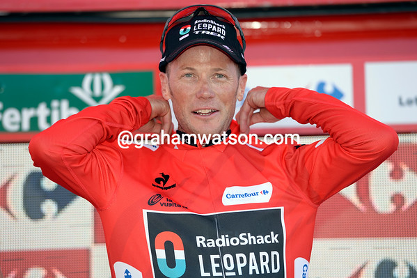 Chris Horner can afford to smile as he re-takes the Red jersey - but an even tougher ten days will begin soon...