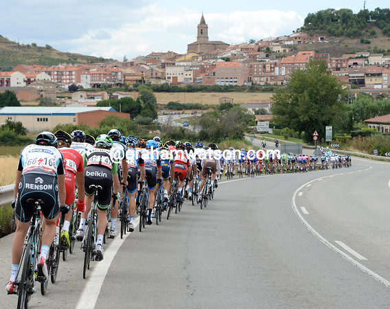 The peloton is now in full flight as it races into a typical hilltop village in Rioja...