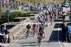 The peloton squeezes over a stone bridge with Lampre still leading the chase...