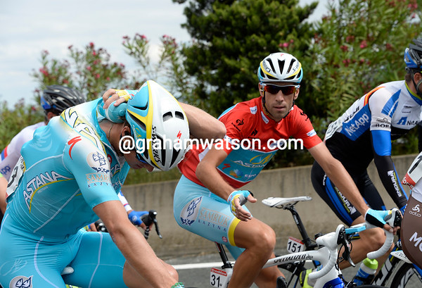 Vincenzo Nibali looks thirsty as he waits for Fuglsang to off-load one of his bottles...