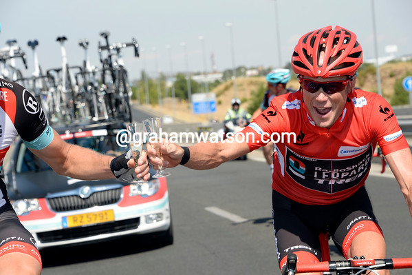 Cheers guy..! Chris Horner touches the glass of Greg Rast, a solid teamate in this Vuelta...