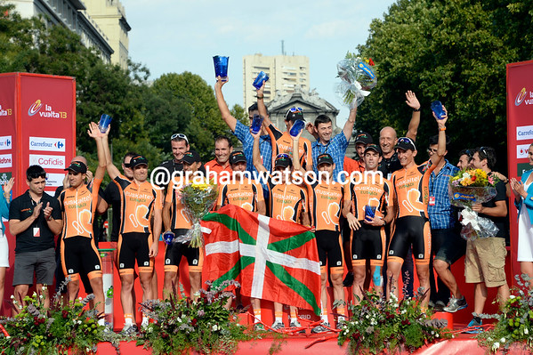 Euskatel bow out of the sport as winners of the team classification, but their pose says an awful lot more...