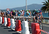 Popovych leads the chase along a causeway divided by plastic barriers - it's too narrow to race flat-out..!