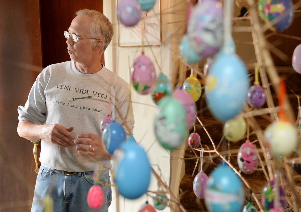 . Dave Thayer paints a handful of easter eggs each year and adds them to his tree of eggs he puts up in his living room every year. Thayer showed off his artwork to the Denver Post Wednesday, April 2, 2014 at his home in Denver. He uses oil paint and real egg shells. (Photo by Karl Gehring/The Denver Post)