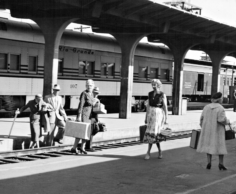. Train passengers, out bound from Denver, cross tracks at Union Station due to a strike of employes at the station in 1956. The passengers carried their own baggage to the correct platform, only to find that supervisors, subbing for rail union workers who had refused to cross picket lines, had brought trains in on the wrong tracks.  (Photo by Ed Maker /The Denver Post)