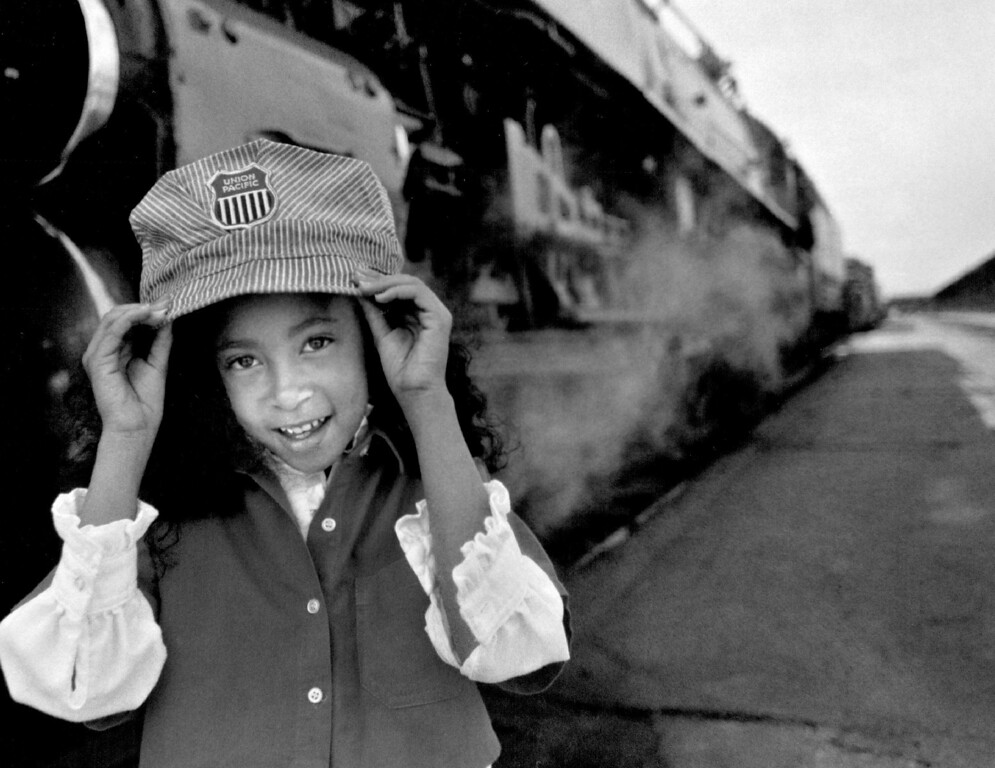. Marisha Anderson from Montbello Christian School on a school tour trying on the engineers hat at Denver Union Station in 1988.  (Photo by John Prieto/The Denver Post)