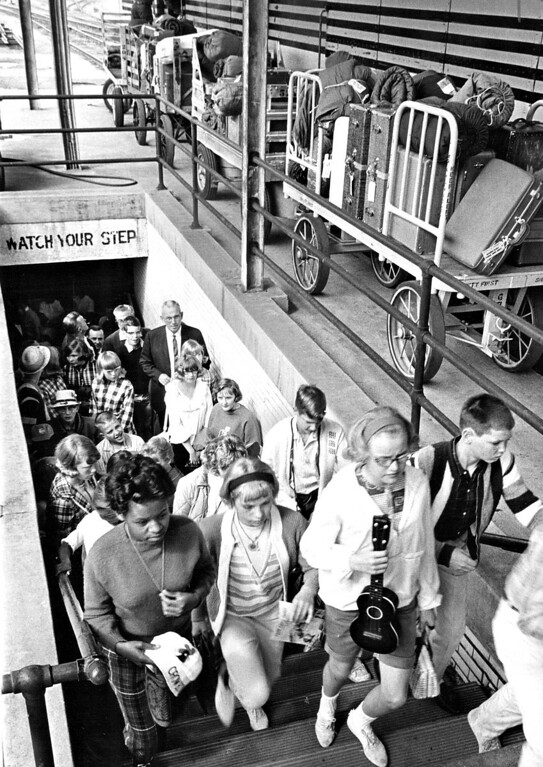 . The first of 154 prospective Camp Chief Ouray campers climb the stairs to board a special Rio Grande train at Denver Union Station for Granby, Colo. The trip will begin the YMCA\'s camping season in 1965.  (Photo by Ed Maker/The Denver Post)