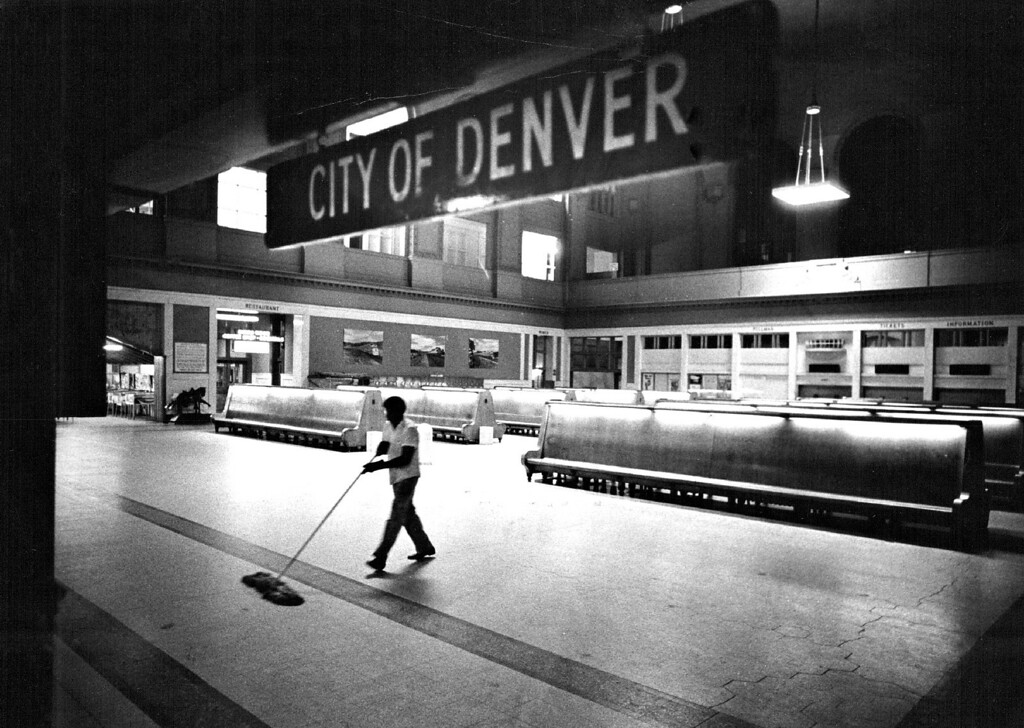 . Ray Ward sweeps the floor of a deserted waiting room in Denver\'s Union Station where business practically came to a standstill awaiting information on a strike threat.  (Photo by David Cupp/The Denver Post)