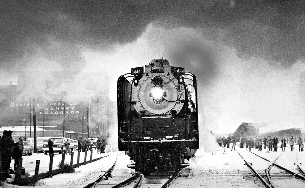 . With a clang of its bell, a chug and a twist of its tremendous wheels, the Union Pacific Railroad\'s last operating steam locomotive, No. 8444, backed into Denver\'s Union Station Saturday morning, February 1, 1975 to pick up cars of a passenger train that was to carry railways buffs on a round trip through nostalgia to Laramie, Wyo. The trip was sponsored by the National Railway Historical Society and may be the last for the engine that was built in 1944.  (Photo by Bill Peters/The Denver Post)