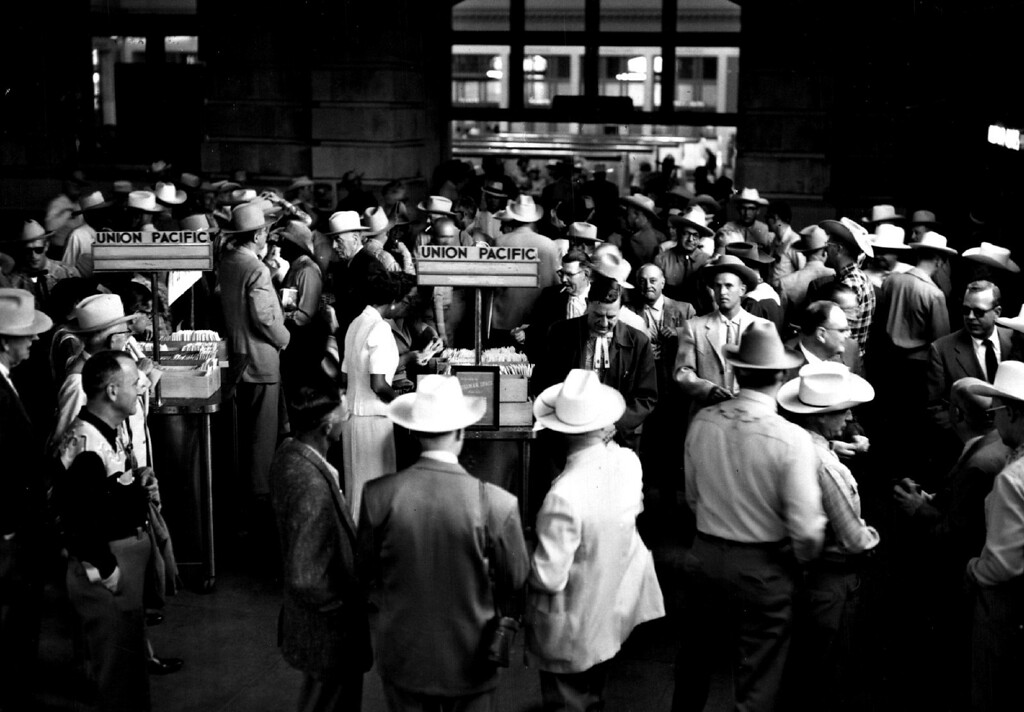 ". Part of the crowd of ""Cowboys-For-A-Day\"" milling about Union Station Tuesday Morning preparing to depart for Cheyenne\'s Frontier Days in 1957.  (Photo by Cloyd Teter/The Denver Post)"