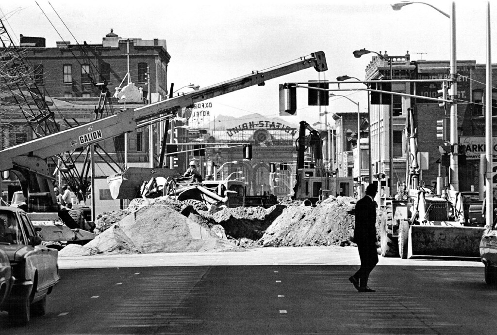 . A Denver landmark, the Union Station, is framed in signs of progress for a new lower downtown area in this view looking west on 17th St. from the intersection of Curtis St on March 24, 1971. The station will have a role in the new Denver, designated as a point on the new Railpax passenger train route from Chicago, III., to San Francisco, Calif.  (Photo by Ernie Leyba/The Denver Post)