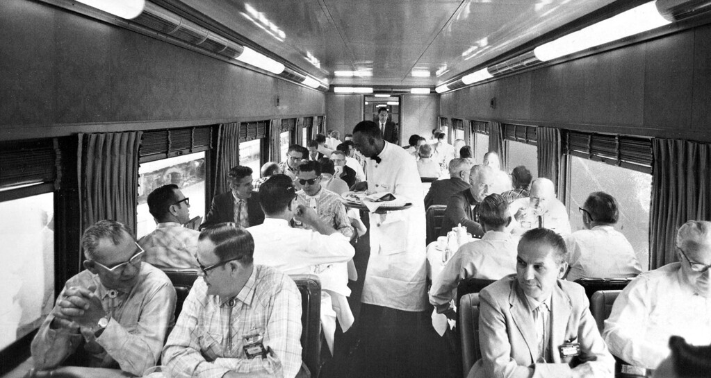 . Passengers board the annual Denver Post Cheyenne Frontier Days train for an early breakfast in the diners cars like this one which handled the more than 1,200 guests on the 27-car special that pulled out of Denver Union Station for Cheyenne at 9:17 a.m.  (Photo by Bill Wunsch/The Denver Post)