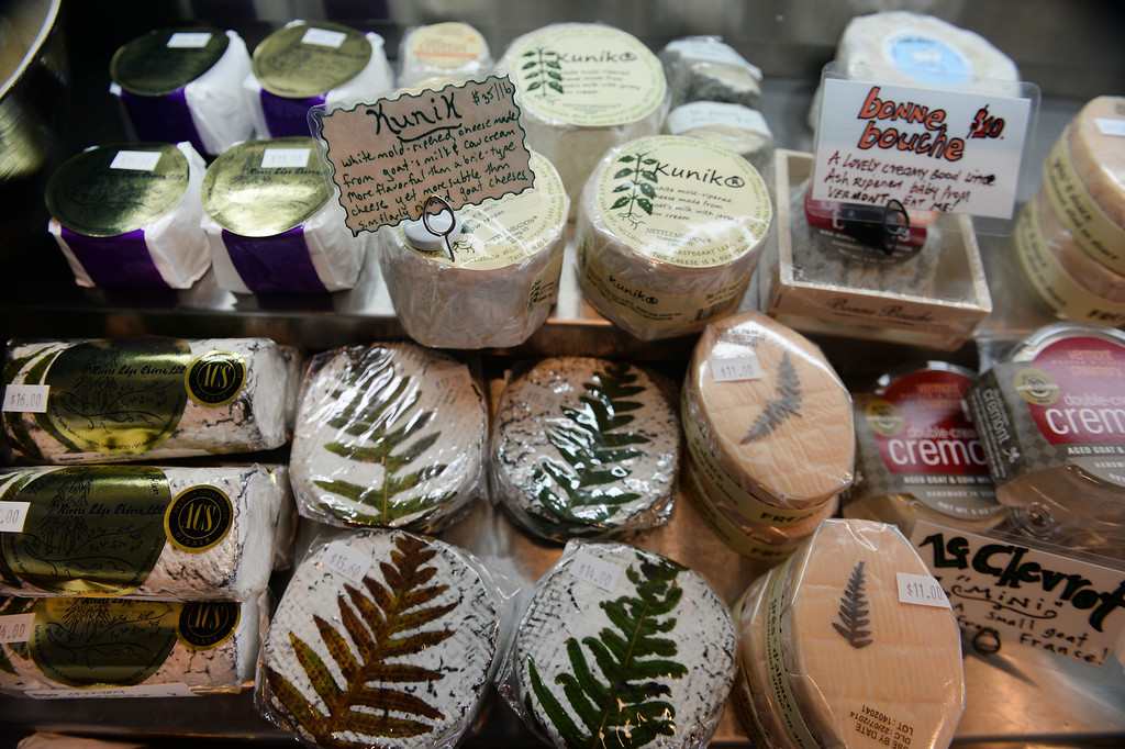. These are an assortment of cheeses available  at St. Kilian\'s Cheese Shop and Market on Lowell and 32nd street in Denver, CO on June 15, 2014.  Jon Marsh and Veronica Martinez are the owners of St. Kilians Cheese Shop and Market which specializes in gourmet and international cheeses as well as meats and sausages. (Photo By Helen H. Richardson/ The Denver Post)
