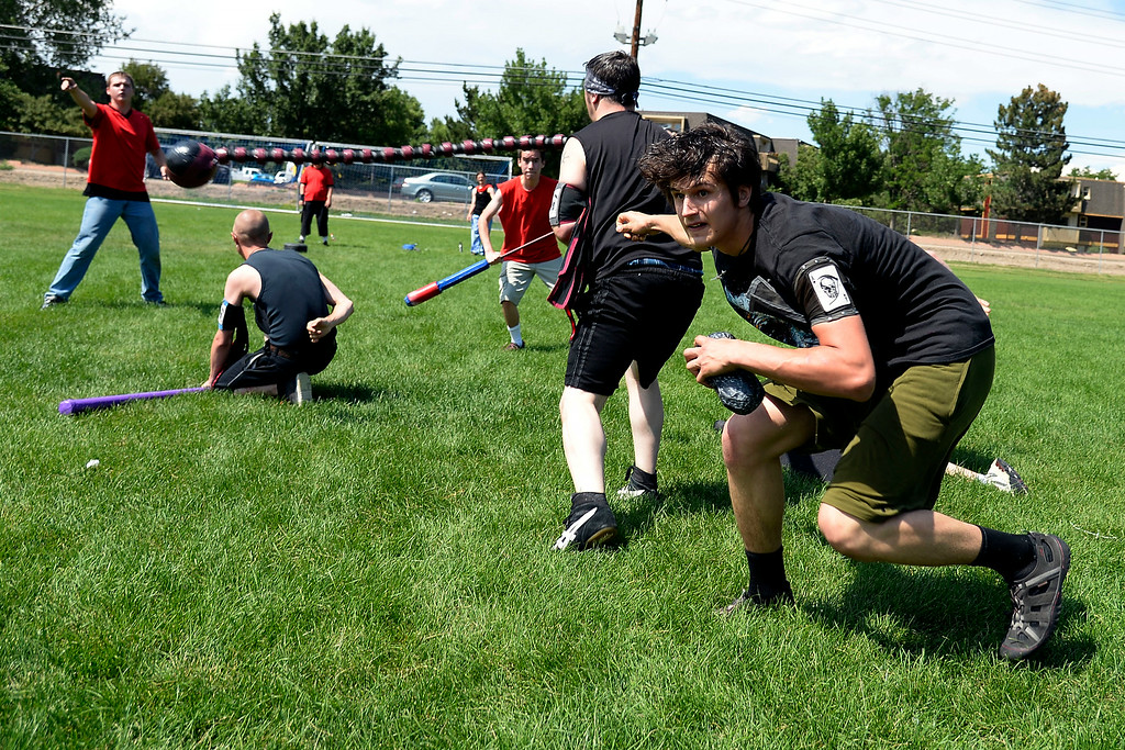 . Ivan Yermilov ducks behind the ball-and-chain-weilding Jake Rawls as he searches for open space to move. The Colorado Jugger League exhibition and barbecue on Sunday, July 13, 2014. (Photo by AAron Ontiveroz/The Denver Post)