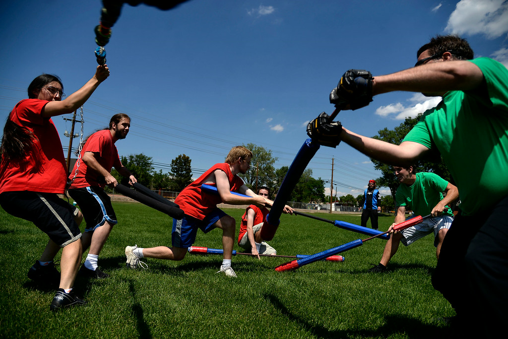 . Players from opposing sides rush to the middle of the battle field to retrieve the jugg (the game\'s skull-like ball). The Colorado Jugger League exhibition and barbecue on Sunday, July 13, 2014. (Photo by AAron Ontiveroz/The Denver Post)