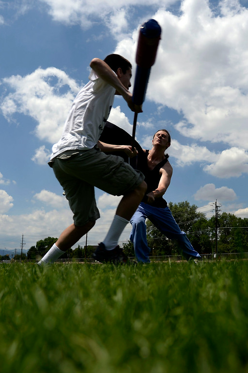 """. Quillen Verner (right) duels Jett Salomonman as they warm up for an exhibition game with an \""""iron man\"""" drill in which one competitor takes on a line of men in successive order until losing. League exhibition and barbecue on Sunday, July 13, 2014. (Photo by AAron Ontiveroz/The Denver Post)"""