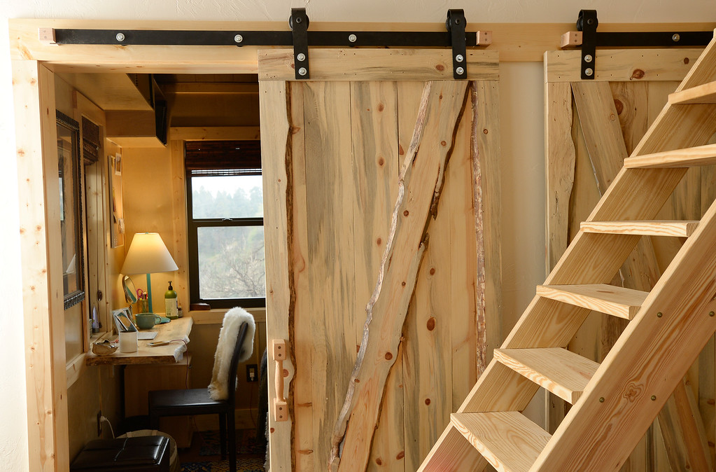 . Detail of office space at the home of David Cottrell and his wife Kristen Moeller. They rebuilt the home following the Lower North Fork Fire in 2012. They went from 1200 square feet to 500 square feet.  The couple both work from home. They were at their home which is up Deer Creek Canyon  on Tuesday, July 15, 2014.  The couple will be featured in an upcoming episode of Tiny House Nation on FYI network.   (Denver Post Photo by Cyrus McCrimmon)