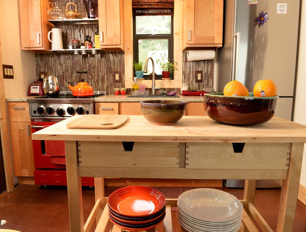 . Detail of kitchen space  at the home of David Cottrell and his wife Kristen Moeller. They rebuilt  the home following the Lower North Fork Fire in 2012. They went from 1200 square feet to 500 square feet. They were at their home which is up Deer Creek Canyon  on Tuesday, July 15, 2014.  The couple will be featured in an upcoming episode of Tiny House Nation on FYI network.   (Denver Post Photo by Cyrus McCrimmon)