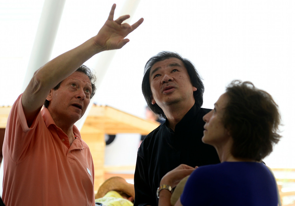 . Japanese Architect Shigeru Ban, center, tours the new Aspen Art Museum with businessman and philanthropist Tom Pritzker and his wife Margot, right. The Aspen Art Museum celebrates its grand opening to the public on Saturday, Aug. 2, 2014. The architect on the project, Shigeru Ban, was there for the celebration which included an official ribbon cutting and fireworks. (Photo by Kathryn Scott Osler/The Denver Post)