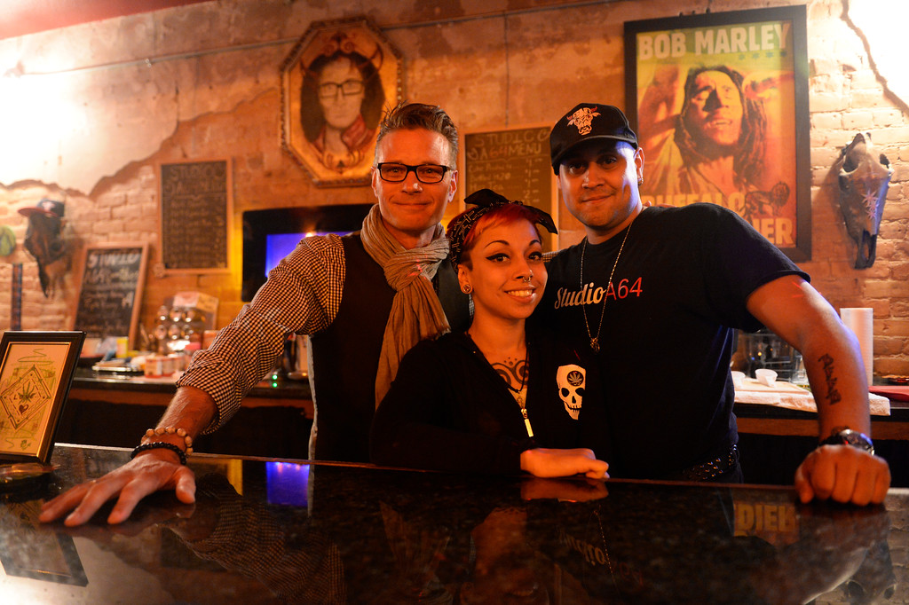 """. COLORADO SPRING, CO. - Studio A64 co-owners from left to right, KC Stark, Janine Choung, and Abner \""""Voodoo� Marrero, at the counter of the the members only cannabis social club, Friday evening, August 15, 2014. (Photo By Andy Cross / The Denver Post)"""