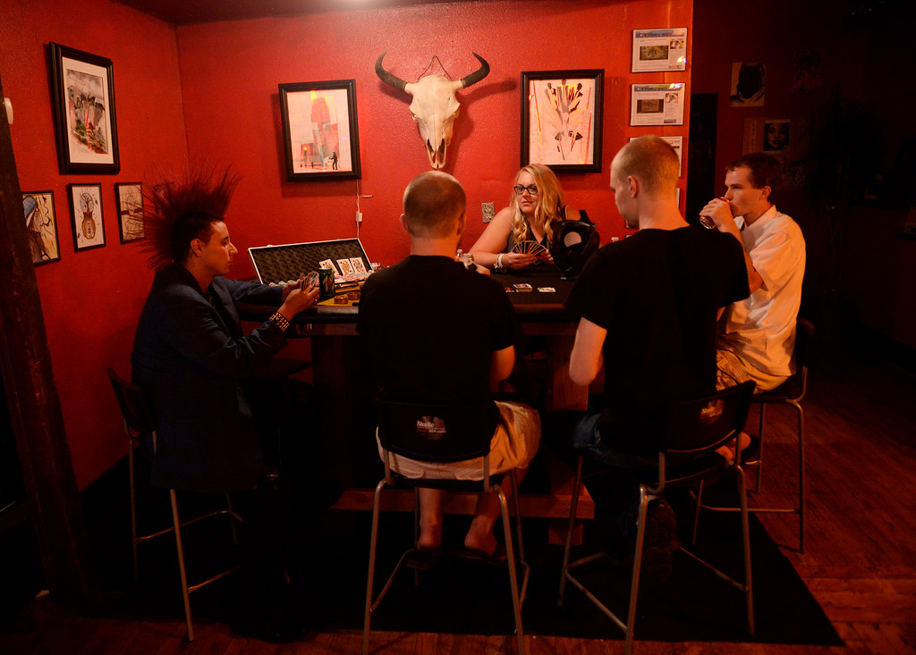 . COLORADO SPRING, CO. - Studio A64 members play a non-gambling game of cards at the members only cannabis social club, Friday evening, August 15, 2014. (Photo By Andy Cross / The Denver Post)
