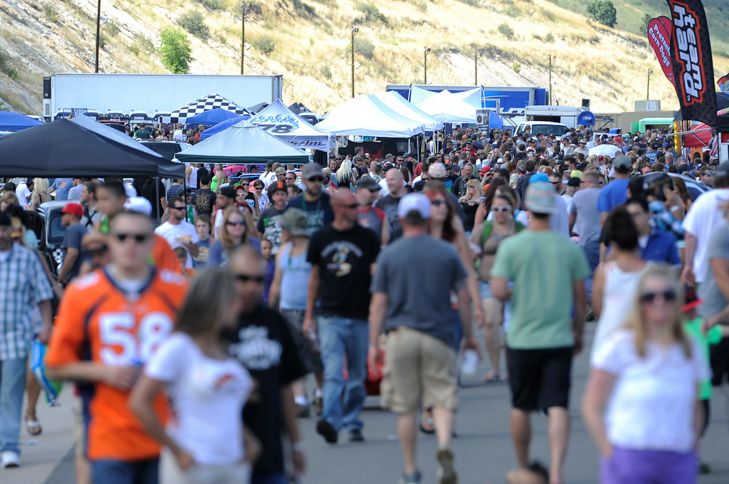 """. More than 13,000 car enthusiasts attend the 10th annual KBPI Rock N Roll car show August 24, 2014 at Bandimere Speedway. There was also a car bash where $1 to take a sledge hammer to a car benefiting \""""US Warriors Outside\"""" providing wooded veterans the opportunity to enjoy their passion for the outdoors. (Photo by John Leyba/The Denver Post)"""