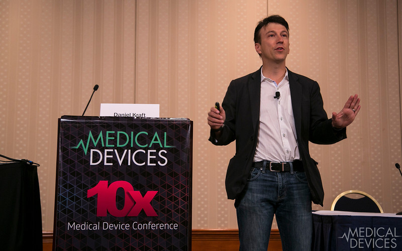Minneapolis, MN - 10X Medical Device Conference - Dr. Daniel Kraft, Keynote speaker demostrates  new device technology  at the 10X Medical Device Conference here today, Tuesday May 13, 2014. The meeting highlighted the latest trends, technology and management in the medical device community.  Photo by © MedMeetingImages/Todd Buchanan 2014 Technical Questions: todd@medmeetingimages.com