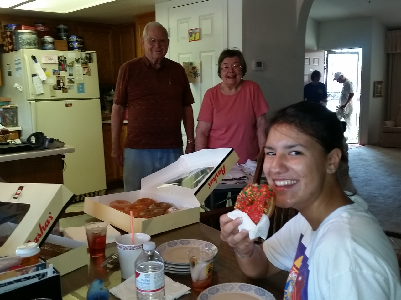 """Bianca tastes her first donut at the Henson home during """"Make A Difference Day"""""""