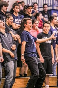 Adam Moody puts the moves on during a musical interlude during the girl's game at Poland Regional High School.