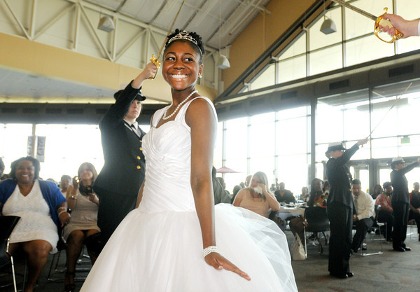 Don Knight | The Herald Bulletin<br /> Alicia O'Neal is introduced during the Debutante Cotillion Beautillion Militaire at Madison Park Church of God on Saturday.