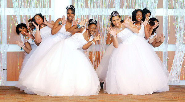 Don Knight | The Herald Bulletin<br /> The Debutante Class of 2014 performs a dance during the Debutante Cotillion Beautillion Militaire at Madison Park Church of God on Saturday.