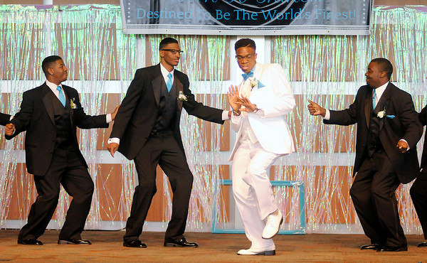 Don Knight | The Herald Bulletin<br /> Ishmeal Allensworth, third from left, dances to a Michael Jackson montage as he is accompanied by this year's escorts during the Debutante Cotillion Beautillion Militaire at Madison Park Church of God on Saturday.