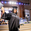 Don Knight | The Herald Bulletin<br /> A graduate acknowledges the crowd after receiving her diploma during Harrison College's graduation at Madison Park Church of God on Friday.