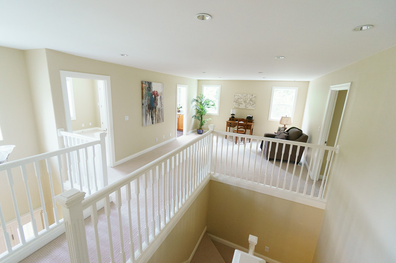 View from the top of the stairs. L-R: Guest bedroom door, guest bathroom, landing (where the toys will go), door to master suite