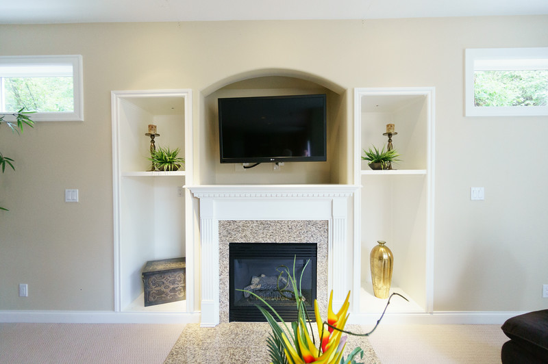family room built-in. Hoping that our TV can be mounted in the space, removing the need for the entertainment center downstairs