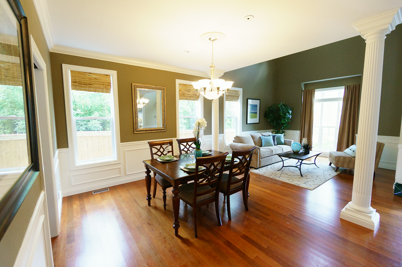 View from the edge of the kitchen/casual dining area into the more formal dining area and front room