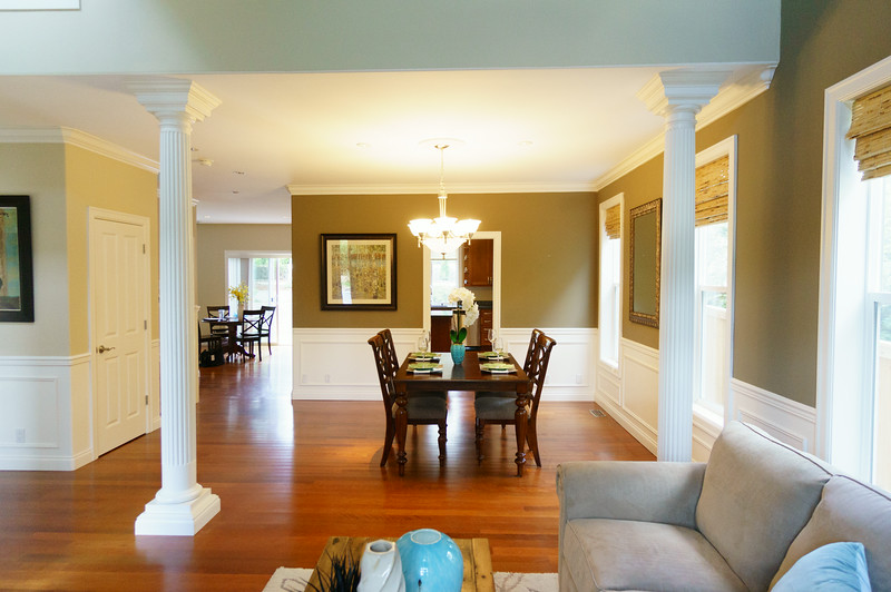 View of formal dining area from front room. Entry closet door to the left. Kitchen door straight through.
