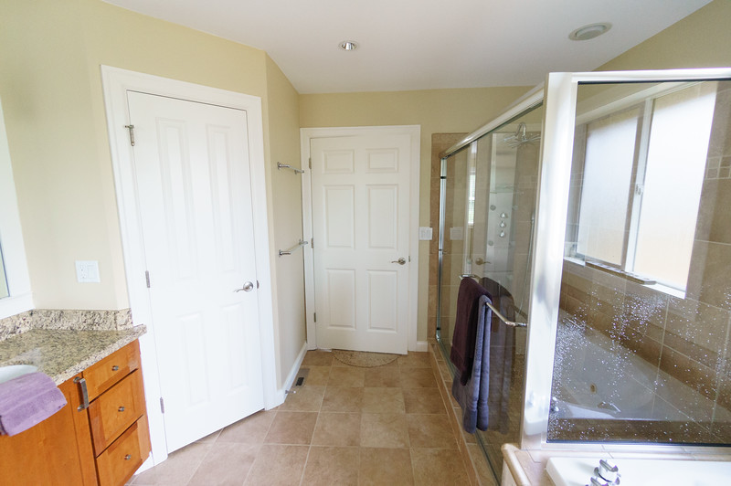 Master bathroom with doors closed.